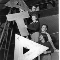 Alpha-Tau-Delta-Students-on-a-Ladder_MPC_1951-02_01-01_01.jpg