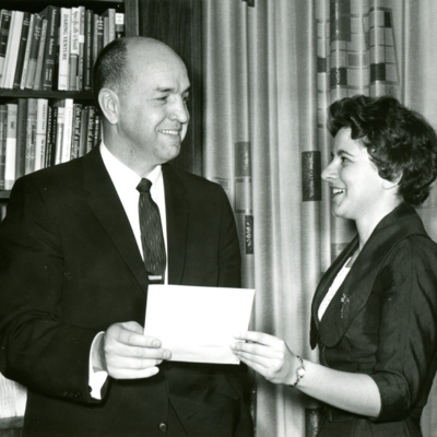 President Palmer Handing Document to Woman 01-02