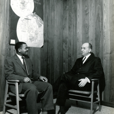 J. Richard Palmer Speaking with Colleague in 1961