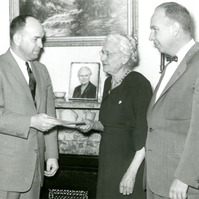 President Palmer Handed Deed by Mrs. Olive Archer 1956 01-02